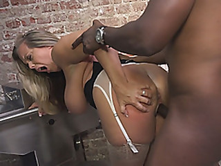 Refulgent mature blonde with huge milk jugs is sucking on a huge black load of shit at hand a jail